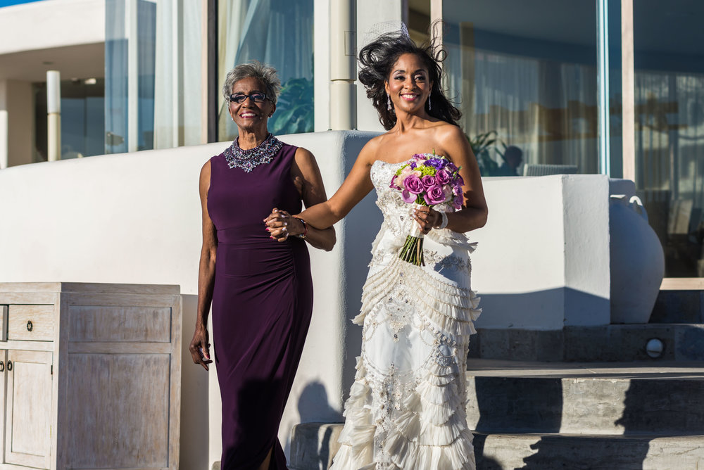 Bride walking to the aisle with her mother on her Cabo destination wedding