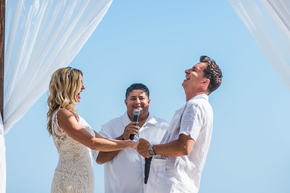 Bride and groom during their ceremony in Cabo