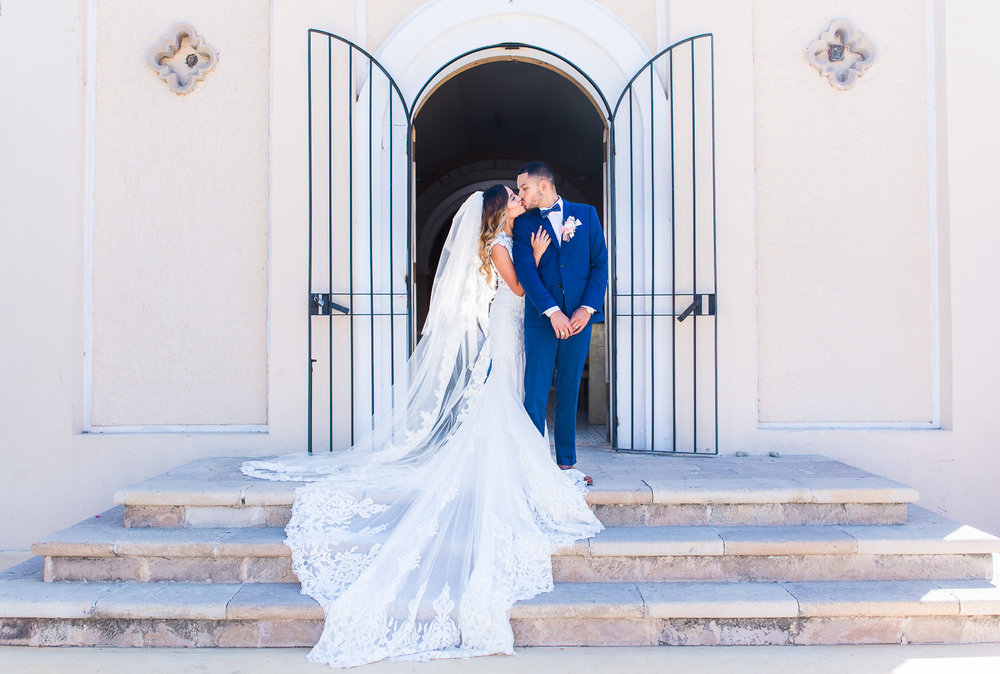 Couple kisses after their wedding ceremony at Cabo San Lucas church