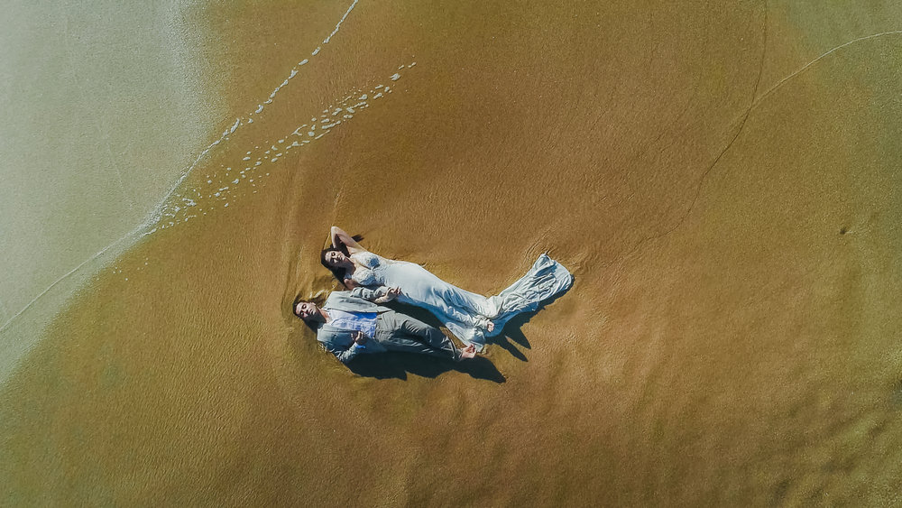 Aerial photoshot of bride and groom during a  trash the dress session in Los cabos