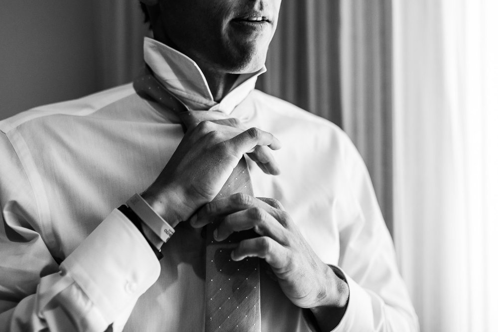 The handsome groom and is getting dressed for the big day of the couple. GVphotographer is an amazing profesional wedding photographer based in Cabo San Lucas, Mexico