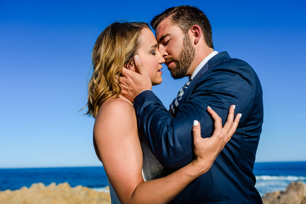 Kissing on the beach bride and groom during their first year anniversary photo session with local photographer GVphotographer