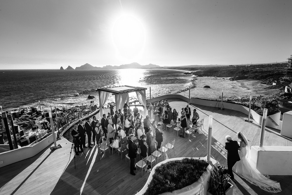 Best Los Cabos Wedding photographer. One Vs Two Wedding photographers. Bride walking down the aisle with his father