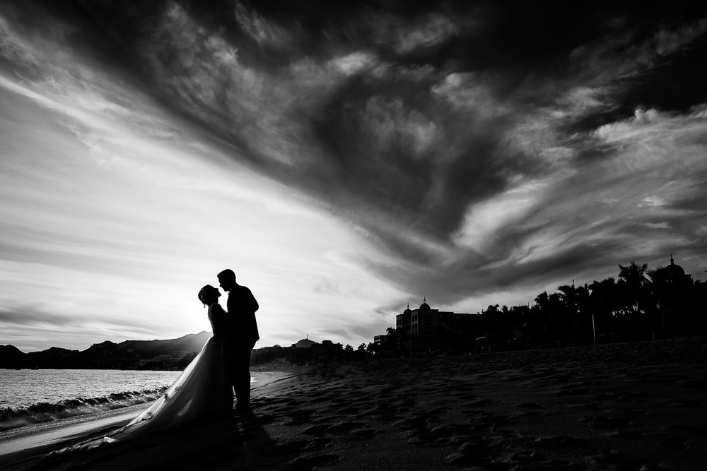 Bride and groom on the beach during their destination wedding day in Los Cabos Mexico