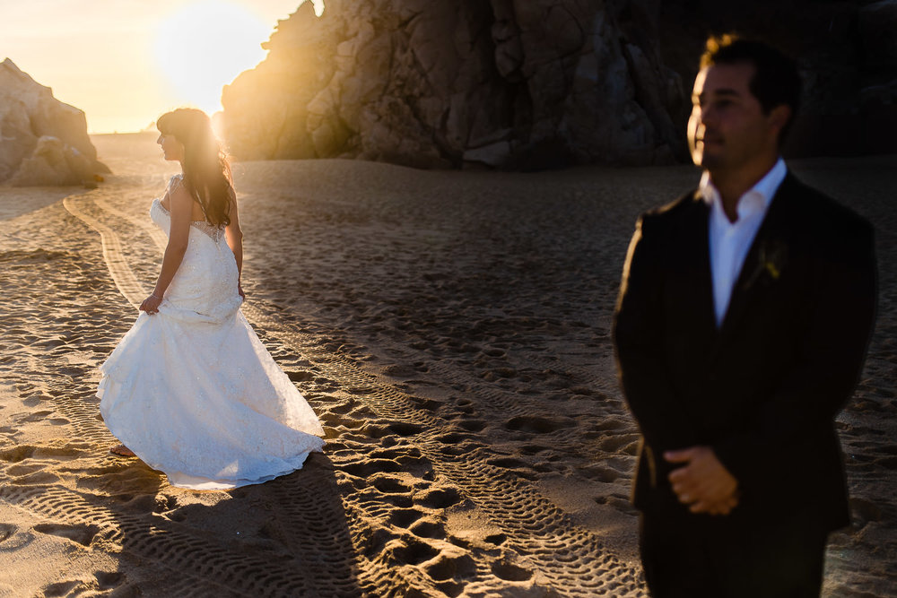 Bride and groom on the beach during theri photosession with talented GVphotographer