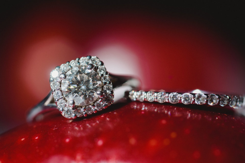 Wedding ring on an apple captured by talented Cabo Wedding photographer GVphotographer