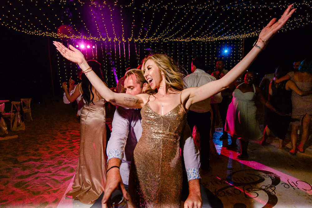 Friends dancing on the dance floor during their Cabo Destination Wedding at El Ganzo Hotel in San Jose Del Cabo, captured by professional Cabo Wedding photographer GVphotographer