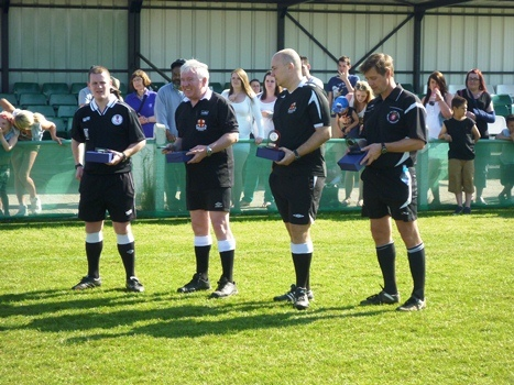 Dewar Shield Match Officials with trophies.JPG
