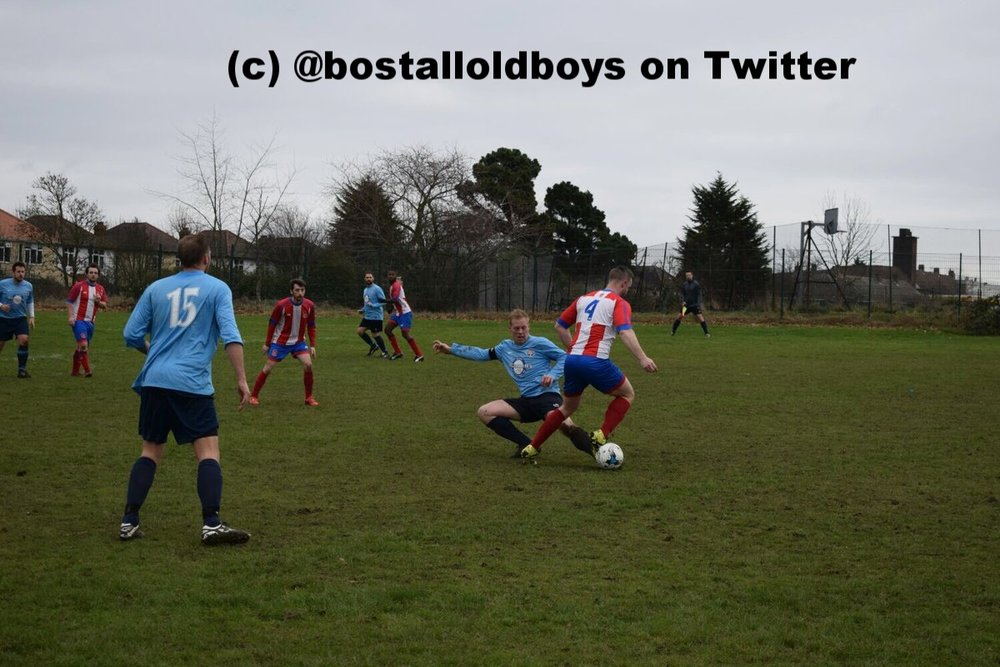 Bostall Old Boys captain Terry Tyrell goes in for a tackle v Elltham Phoenix during their 1-1 draw