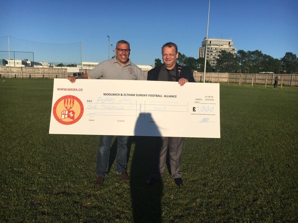 Chairman Dave Fone presents William Seaward from the Royal British Legion with the £1000 chqeue before the Bert Holloway Cup Final.