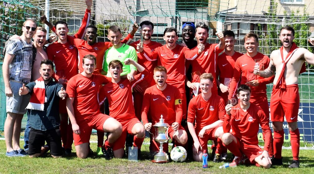 Junior Reds Athletic celebrate winning the Bert Holloway Cup at VCD FC