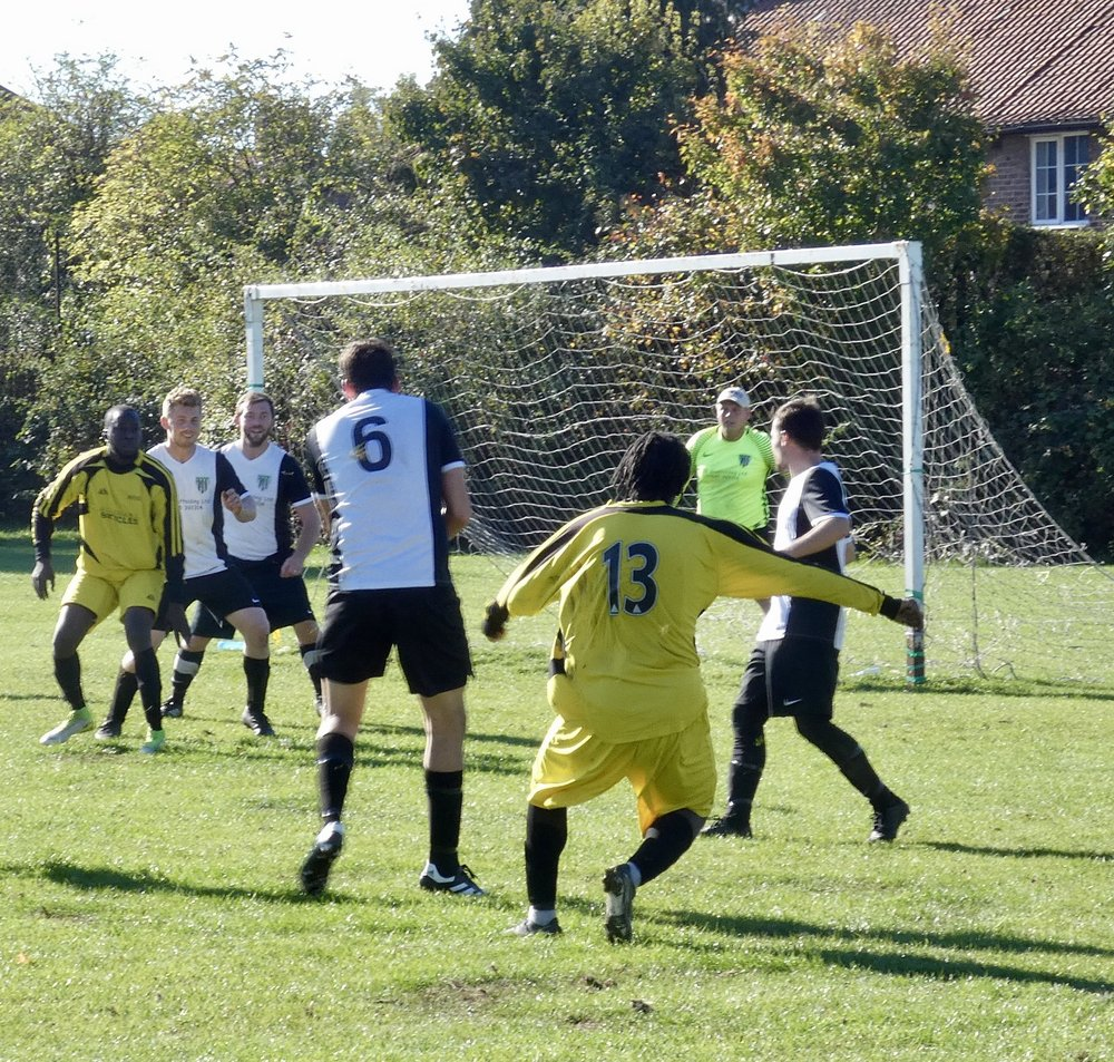 Number 13 of Brockley from the London & Kent Suburban League fires in the late equaliser against Orpington Eagles which turns the game in their favour. (C) Dave Hooker.
