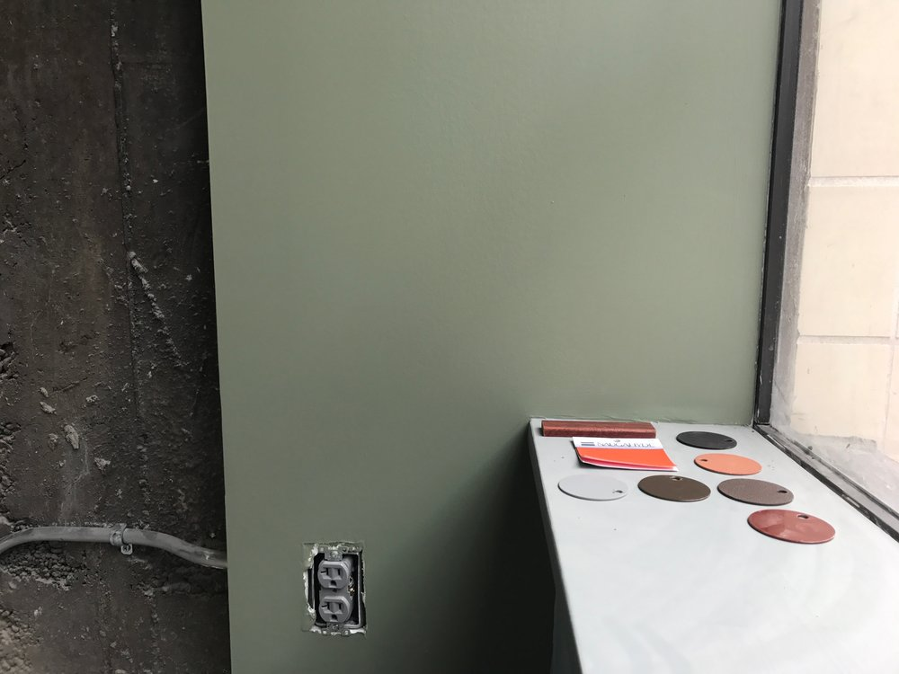 Choosing finishes for the bar stools. I spec'd the wood stain to match the booths, the right orange naugahyde, and the metals. Oh, and make it look good with all the walls being different colors.