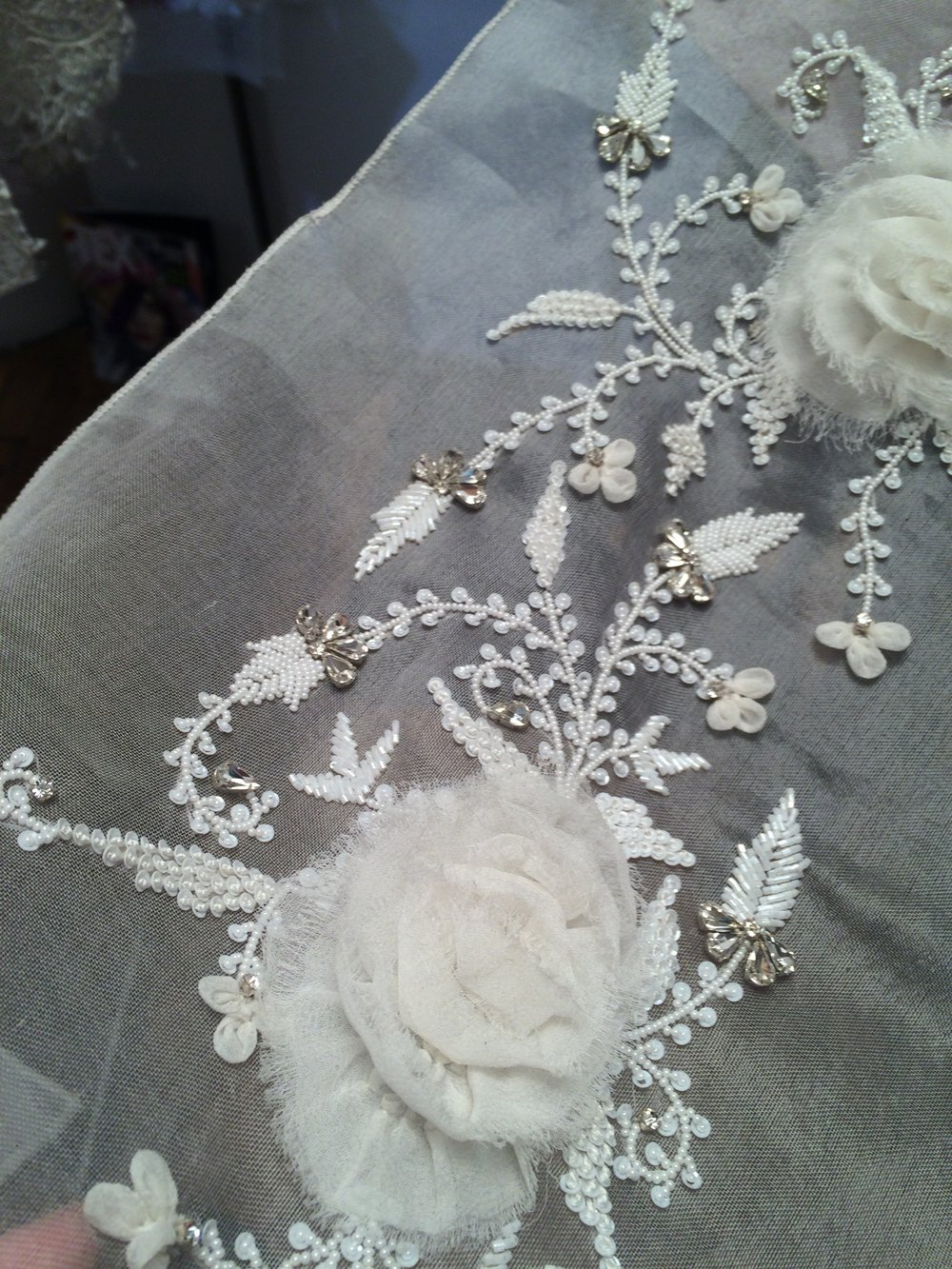 Three dimensional large scale flowers with beading and diamante detail