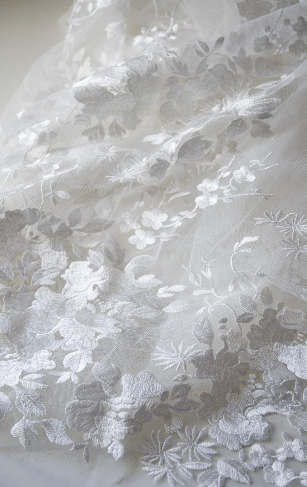 Large scale embroidered tulle
