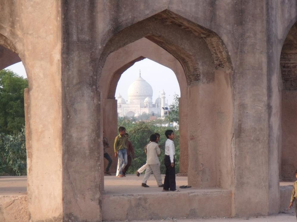 Boys play cricket in front of Taj Credit: Sarika Seshadri