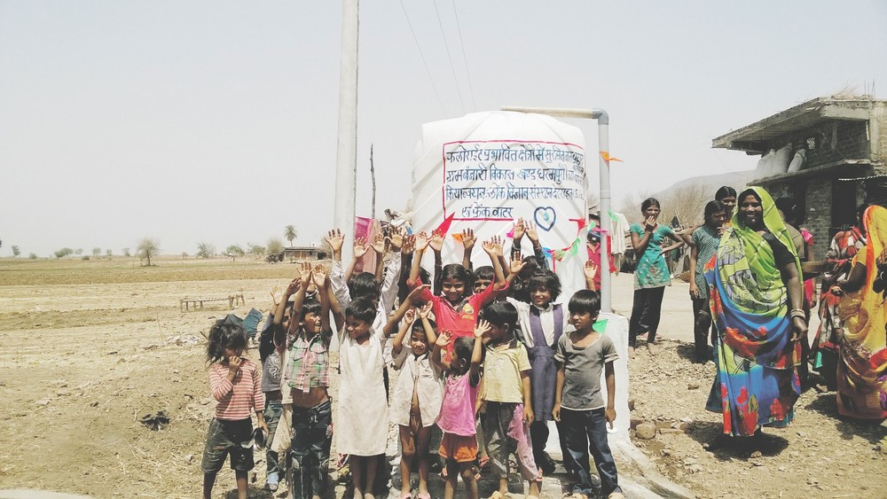 Children celebrate their new safe water supply