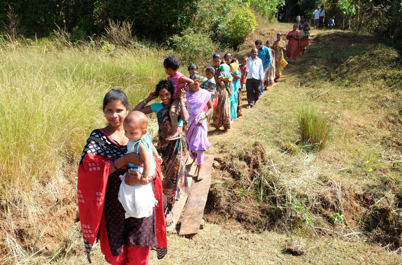 Women walk the 1km journey to their nearest water source.