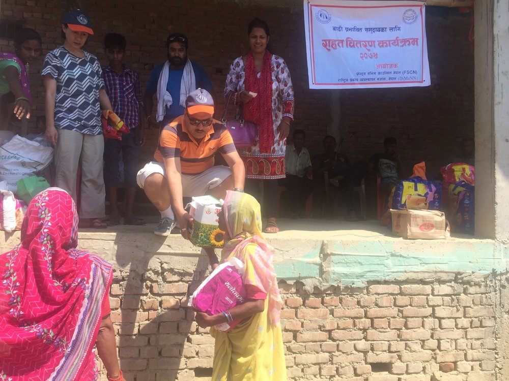 Relief is distributed among flood affected people