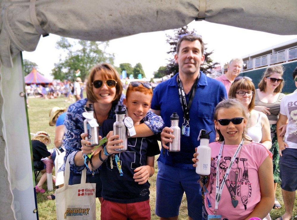 Family refilling with water thanks to FRANK Water Festival Refill Service