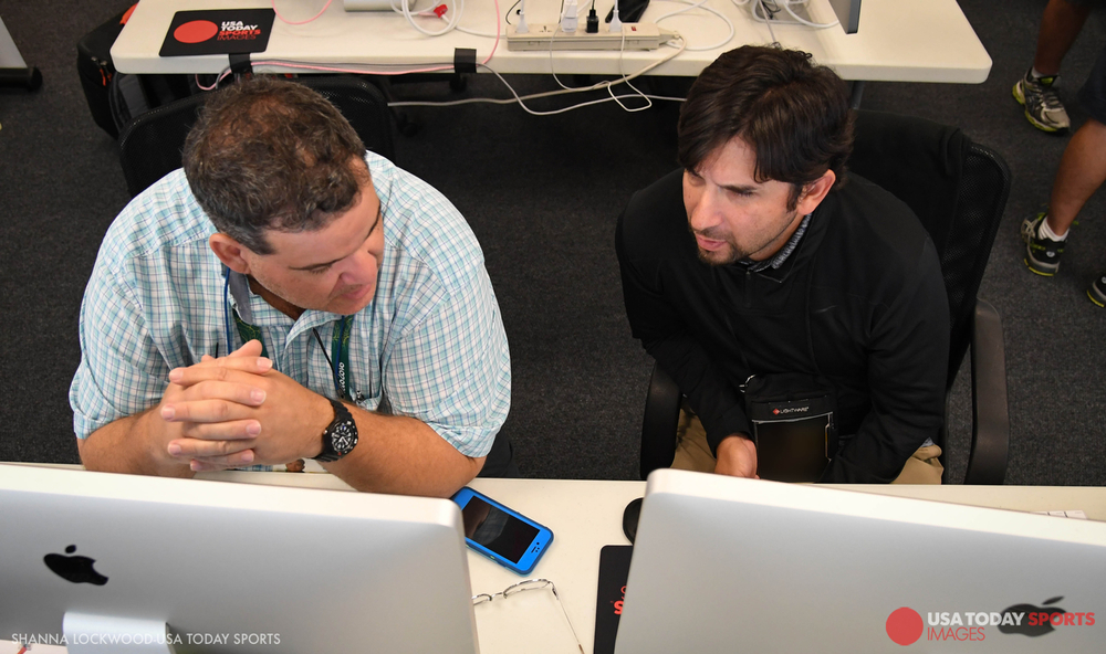 USA TODAY Sports Images photo editors Glenn Andrews (left) and Emmanuel Lozano (right) go over opening ceremony plans.