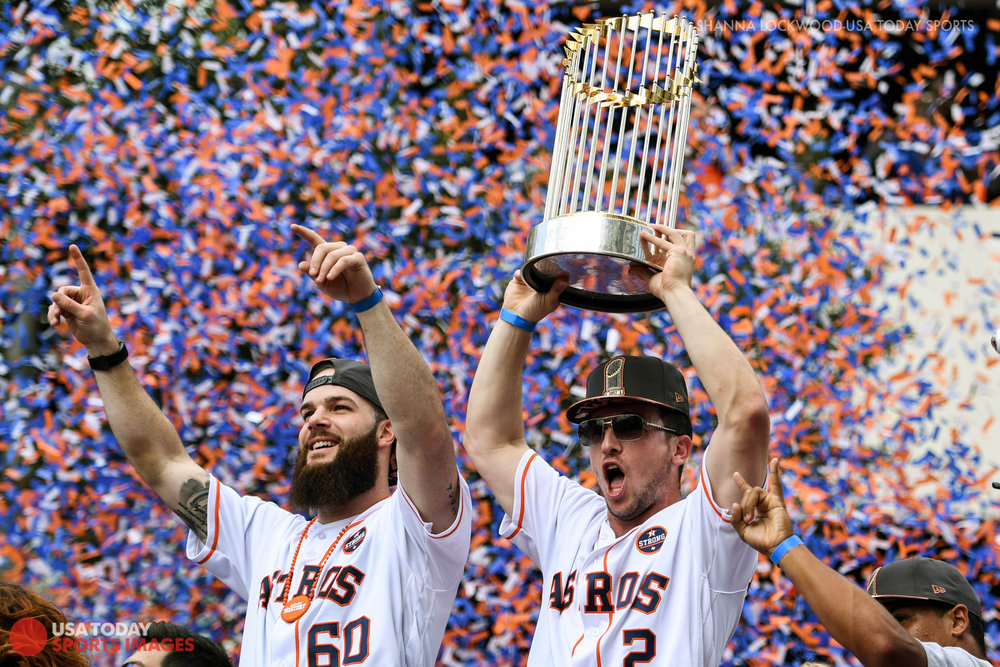 Nov 3, 2017; Houston, TX, USA; Houston Astros third baseman Alex Bregman (2) and starting pitcher Dallas Keuchel (60) during the World Series parade. Mandatory Credit: Shanna Lockwood-USA TODAY Sports