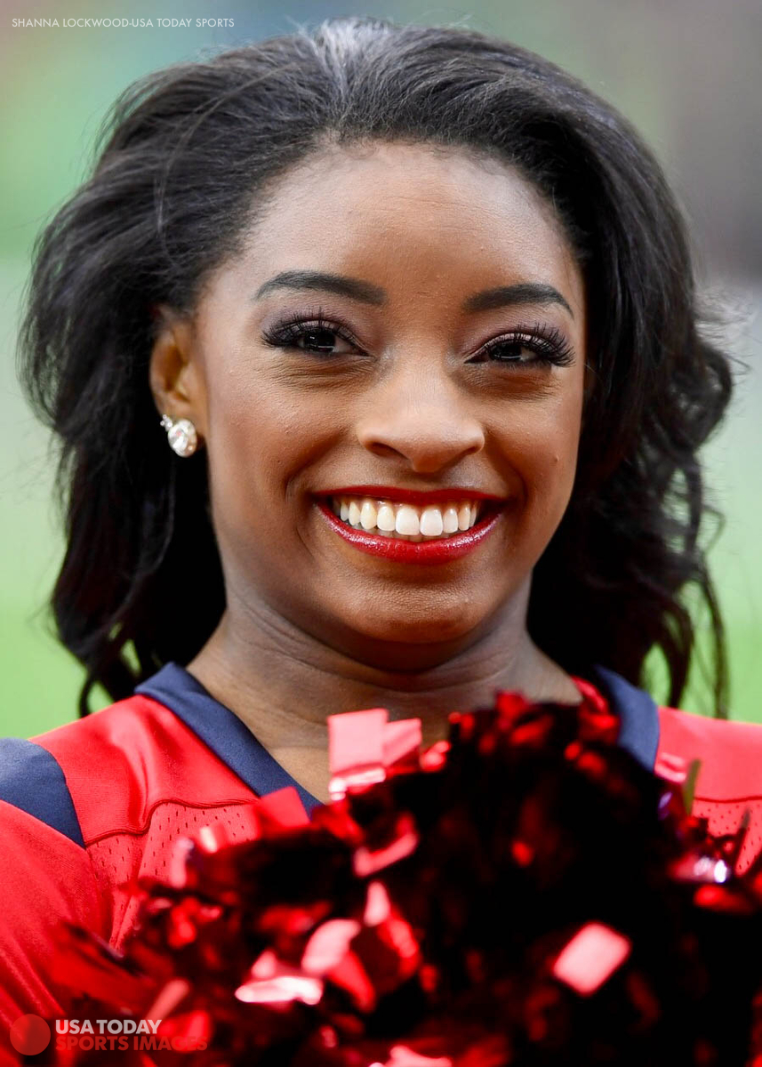 Dec 10, 2017; Houston, TX, USA; Olympic gymnast Simone Biles cheers with the cheerleading team during the first quarter between the Houston Texans and the San Francisco 49ers at NRG Stadium. Mandatory Credit: Shanna Lockwood-USA TODAY Sports