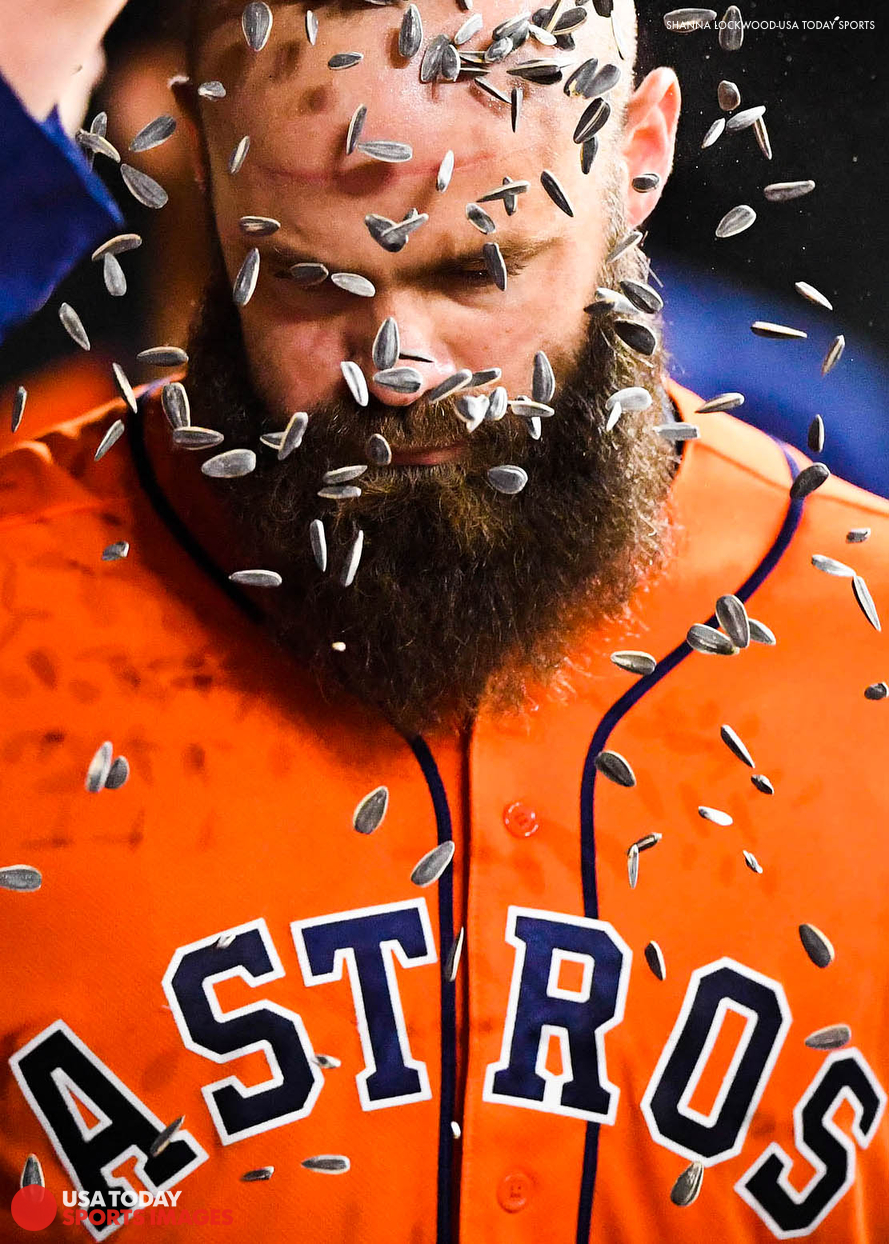 Jun 1, 2018; Houston, TX, USA; Houston Astros catcher Evan Gattis (11) has sunflower seeds poured over his head after hitting a two-run home run during the eighth inning against the Boston Red Sox at Minute Maid Park. Mandatory Credit: Shanna Lockwood-USA TODAY Sports