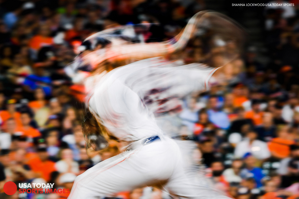 May 22, 2018; Houston, TX, USA; (Editor's Note: Slow-shutter photo.) Houston Astros starting pitcher Gerrit Cole (45) delivers a pitch during the sixth inning against the San Francisco Giants at Minute Maid Park. Mandatory Credit: Shanna Lockwood-USA TODAY Sports