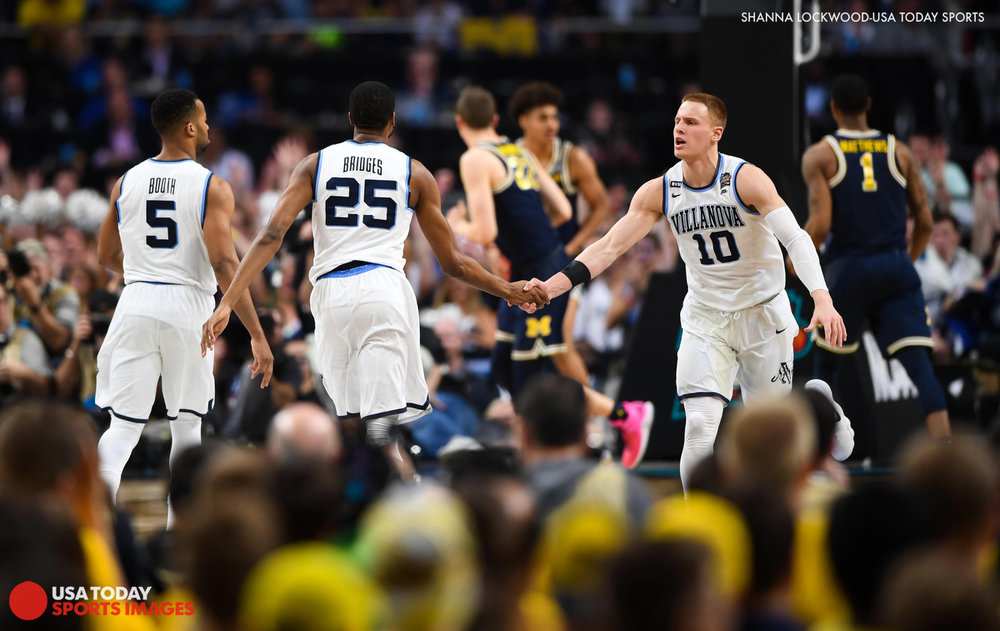 Apr 2, 2018; San Antonio, TX, USA; Villanova Wildcats guard Donte DiVincenzo (10) celebrates with guard Mikal Bridges (25) and guard Phil Booth (5) in the second half against the Michigan Wolverines in the championship game of the 2018 men's Final Four at Alamodome. Mandatory Credit: Shanna Lockwood-USA TODAY Sports