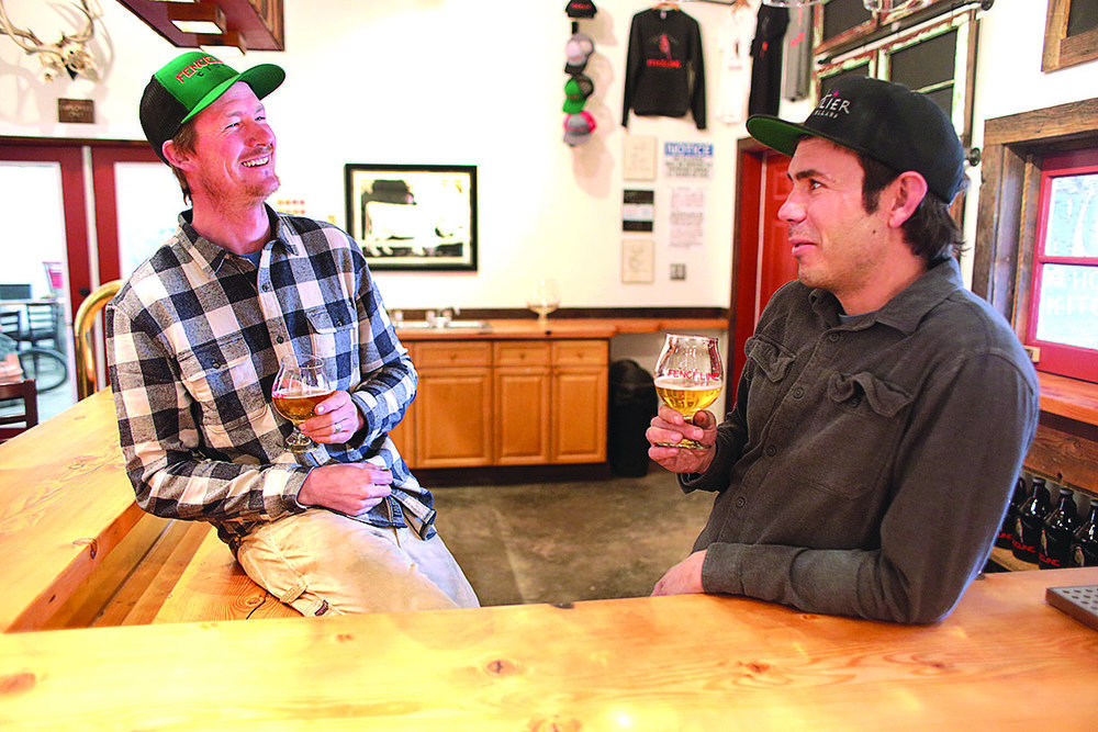 Outlier Cellars' owners, Sam Perry, left, and Neal Wight, right, partake in another grueling sampling session inside their new taproom in Mancos. They went into business a year ago and are now ready for the prime time, with a grand opening this Saturday./Photos by Jennaye Derge