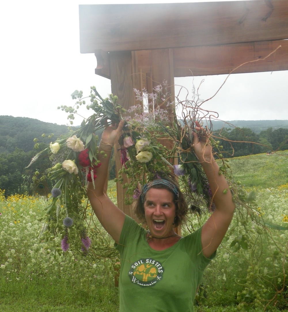 Bench-pressing bouquets for the arbor design, just before the next round of rains. Photo by Mary Jo Borchert, Five Green Acres
