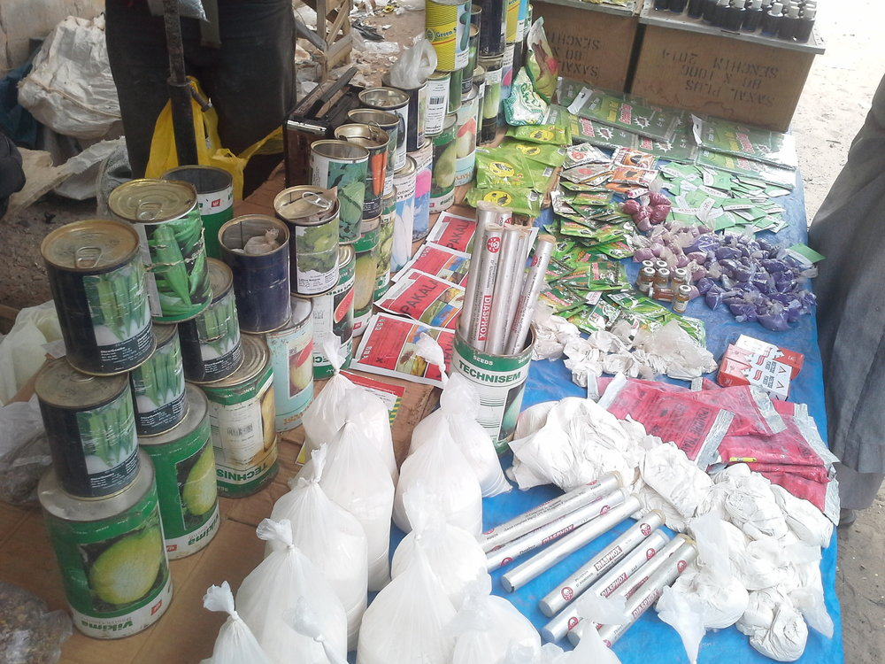 seeds and chemicals at the Mabo market.jpg
