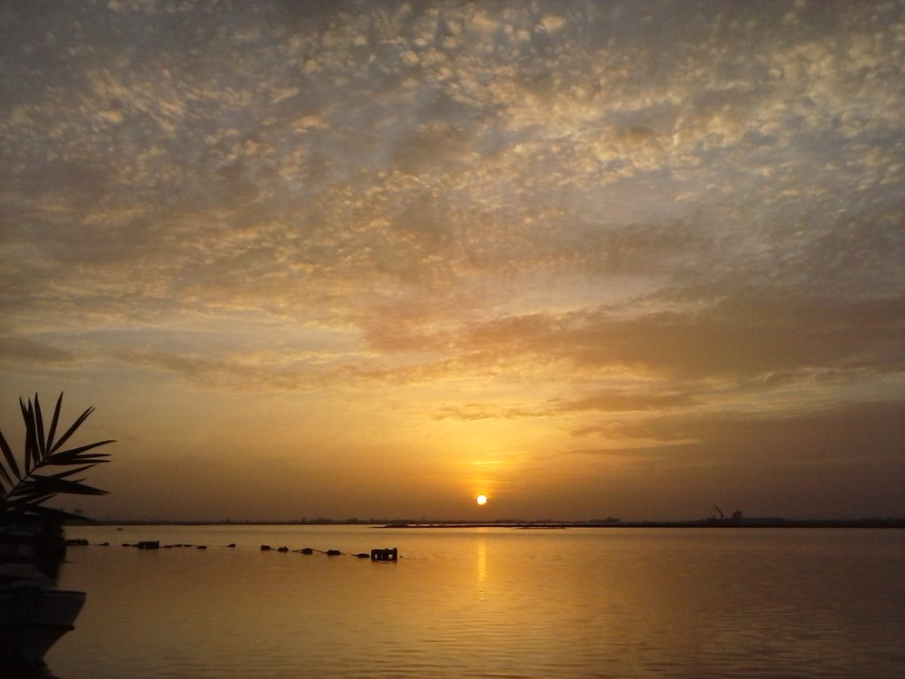 Morning sunrise over the Saloum River, Kaolack, Senegal. This time round, I arrived at the start of the dry season. Photo by Erin Schneider