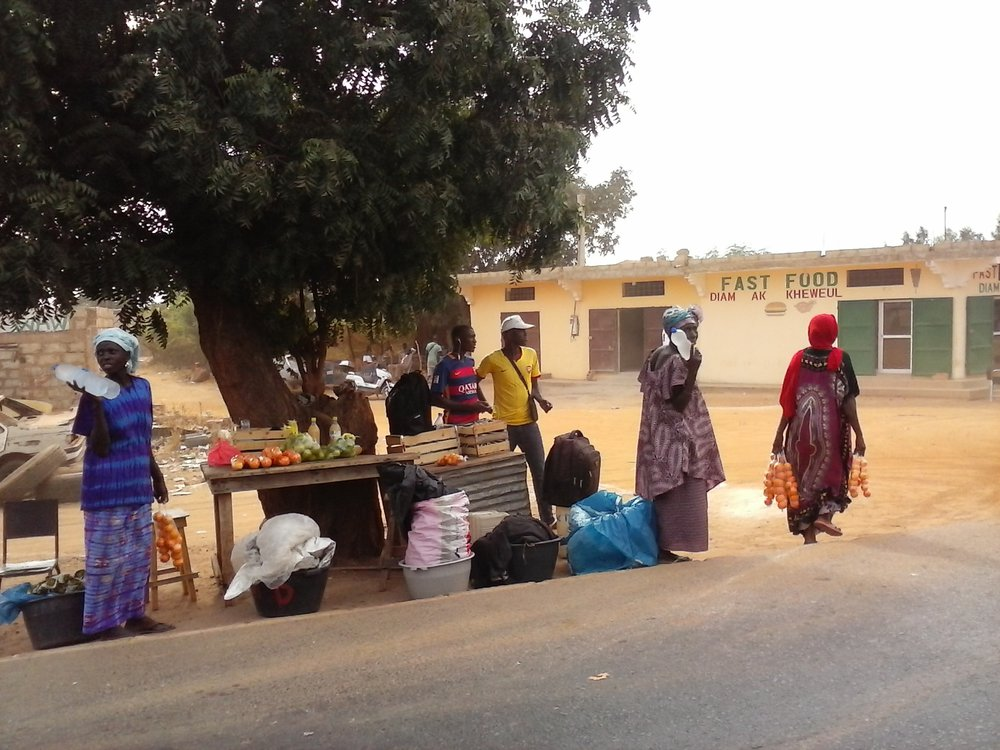 hawking roadside wares en route to Mbour.jpg
