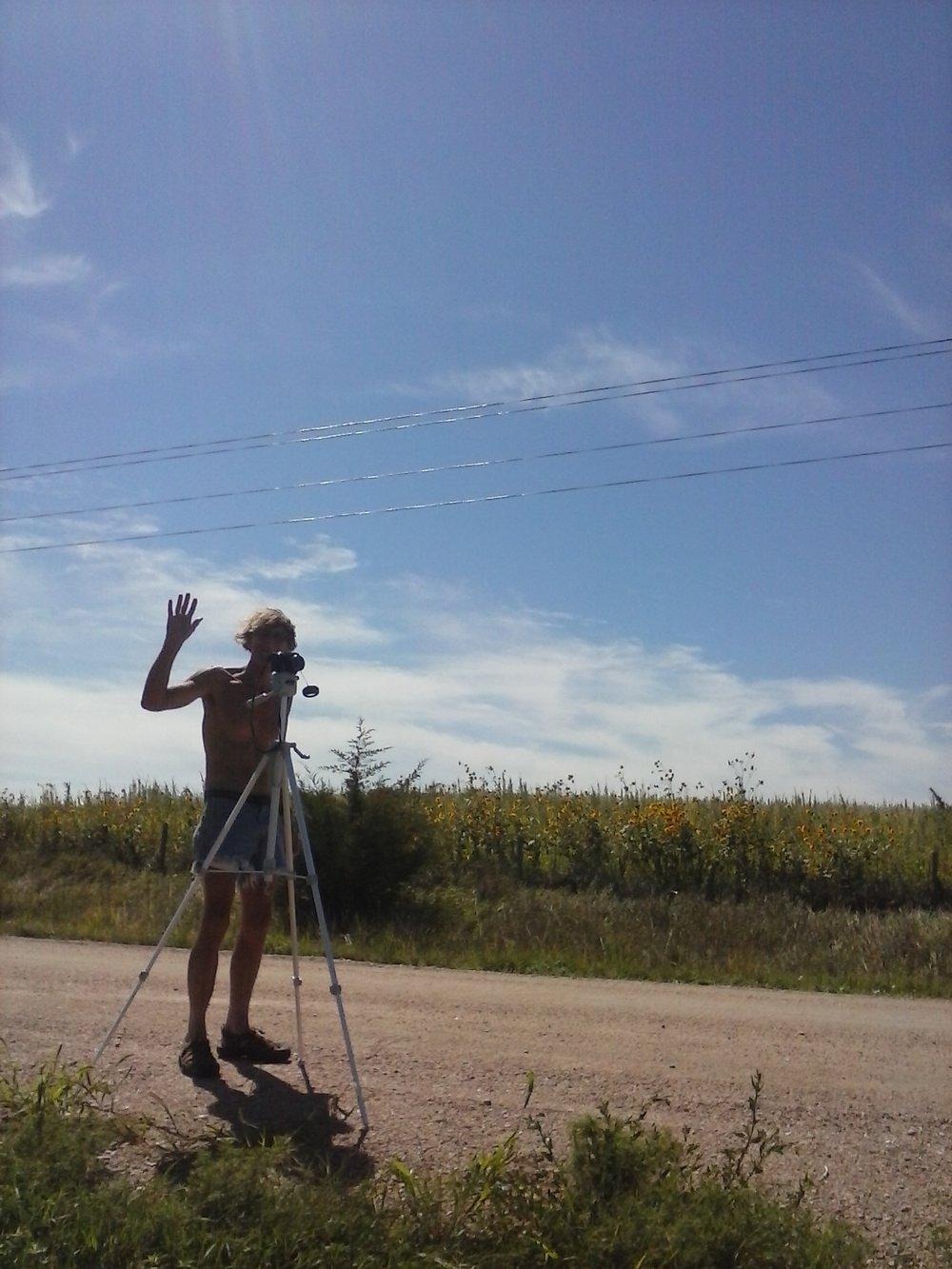 Rob setting up camera in rural Nebraska in anticipation of the total solar eclipse. Photo by Erin Schneider