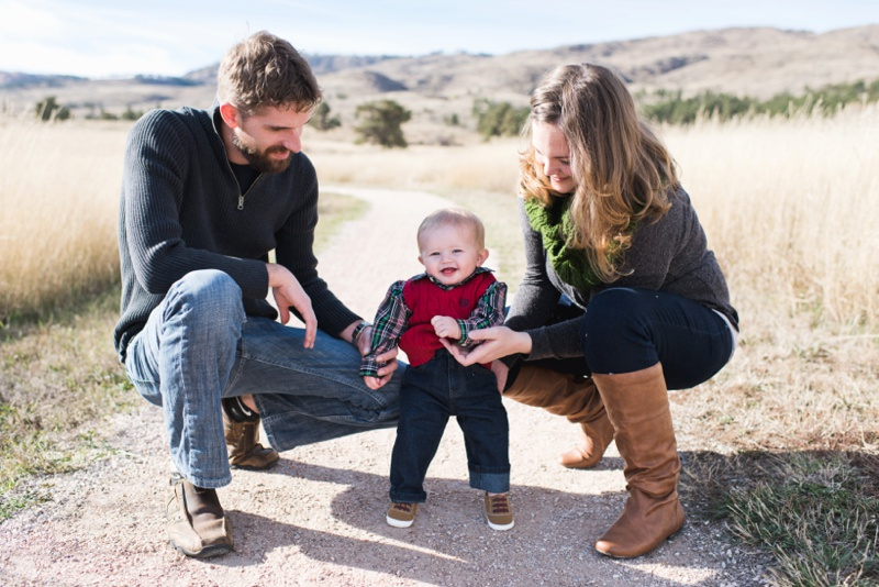 A happy family on a warm fall day outside in the prairie of Colorado. Family film photography by Sonja Salzburg of Sonja K Photography.