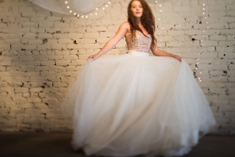 A stunning redhead bride in a beautiful flowing lace wedding dress from Pure Magnolia. Styled shoot and film photography by Sonja Salzburg of Sonja K Photography.