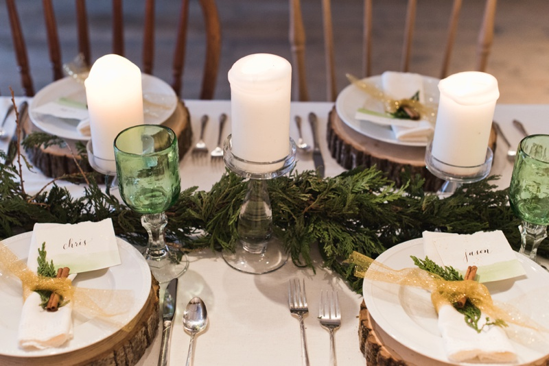 A candlelit winter wedding table with hand written calligraphy. Styled shoot and film photography by Sonja Salzburg of Sonja K Photography.