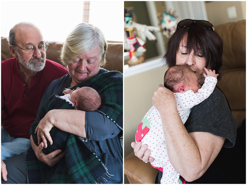 Proud grandparents lovingly hold their sleeping newborn granddaughter. Film family portraits by Sonja Salzburg of Sonja K Photography.