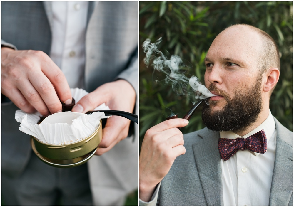 A man in a suit and tie loads a tobacco pipe and relaxes with a smoke. Bow tie by Knotty Tie. Film photography by Sonja Salzburg of Sonja K Photography.