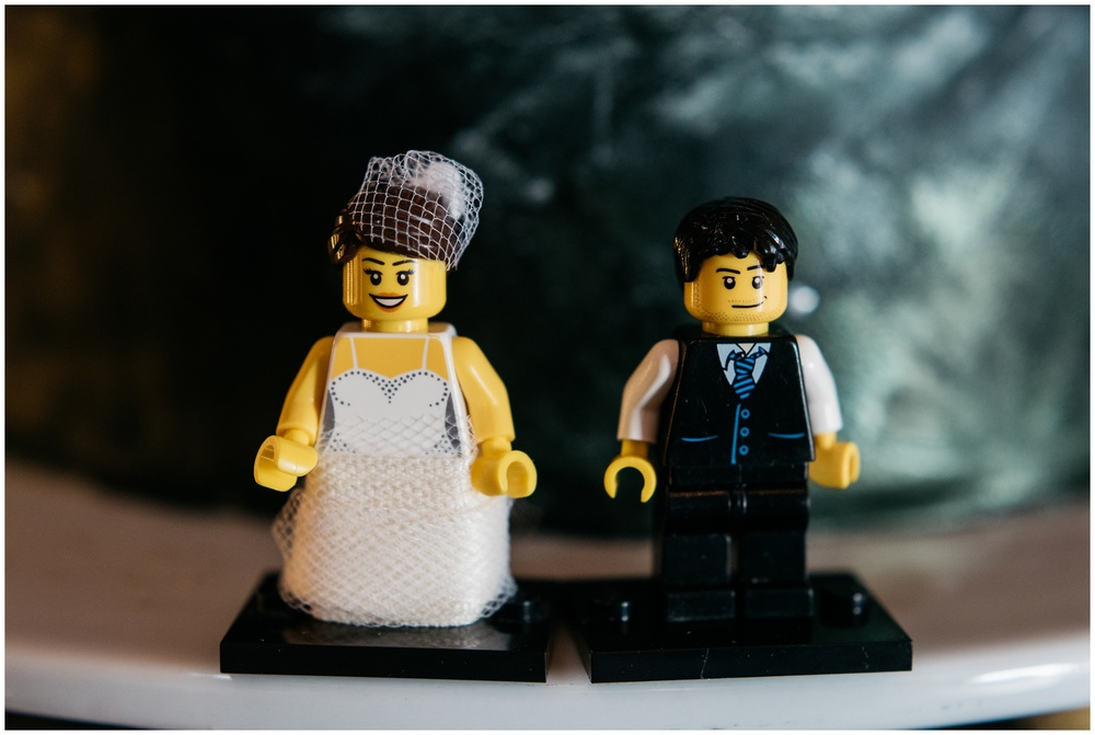 A fun lego bride and groom cake topper. Film wedding photography by Sonja Salzburg of Sonja K Photography.