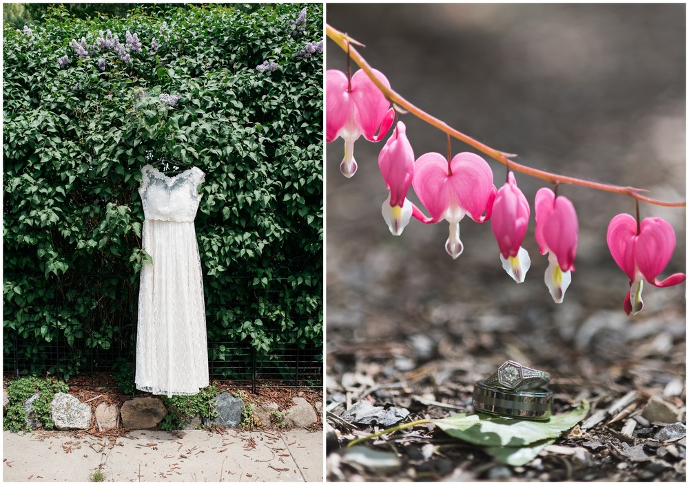 vintage wedding dress hangs outside in a lilac bush in Georgetown, Colorado and a bride and groom's wedding rings sit under bleeding heart flowers photographed by Sonja Salzburg of Sonja K Photography.