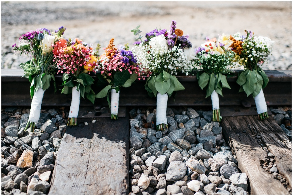 Colorful bouquets just before a wedding. Wedding photography by Sonja Salzburg of Sonja K Photography.