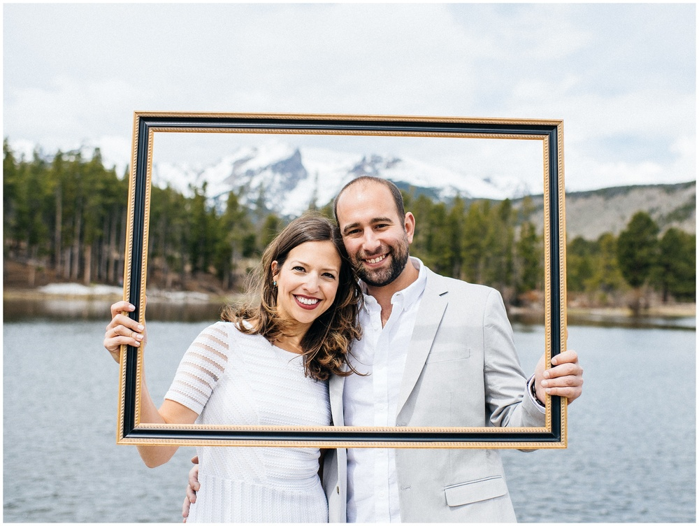 A beautiful, young couple at Sprague Lake in Rocky Mountain Park, Colorado. Engagement photography by Sonja Salzburg of Sonja K Photography.