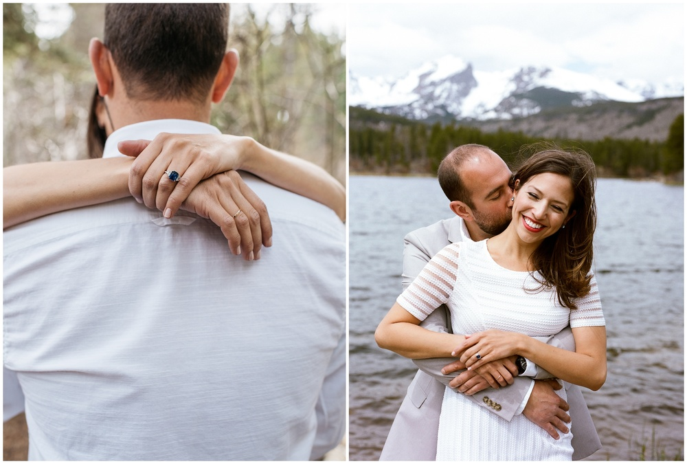 A young couple embraces at Sprague Lake in Rocky Mountain National Park. Engagement photography by Sonja Salzburg of Sonja K Photography.