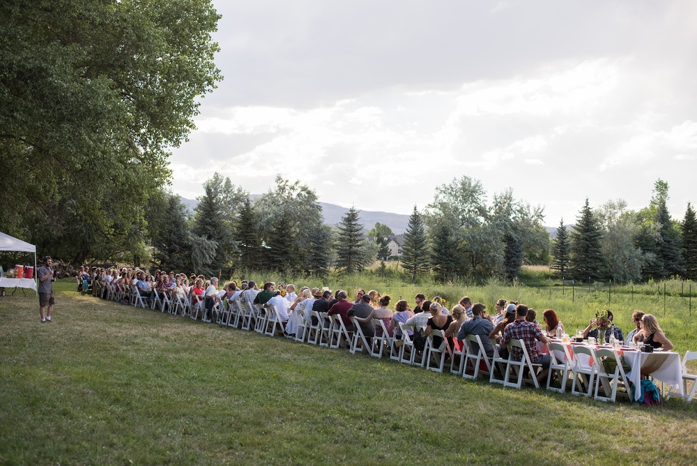 The table for the Fortified Collaborations Heart of Summer Farm Dinner at Happy Heart Farm in Fort Collins, Colorado. Event photography by Sonja Salzburg of Sonja K Photography.