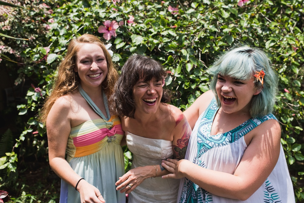 Luna, Maarit, and Gwen share a laugh near Naalehu, Hawaii. Anniversary portrait photography by Sonja Salzburg of Sonja K Photography.