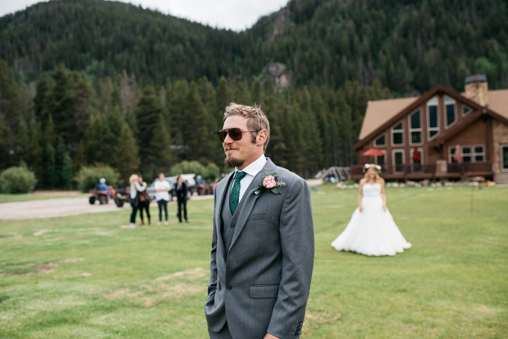 A groom gets ready for a first look before his wedding at Camp Hale near Vail, Colorado. Wedding photography by Sonja Salzburg of Sonja K Photography.