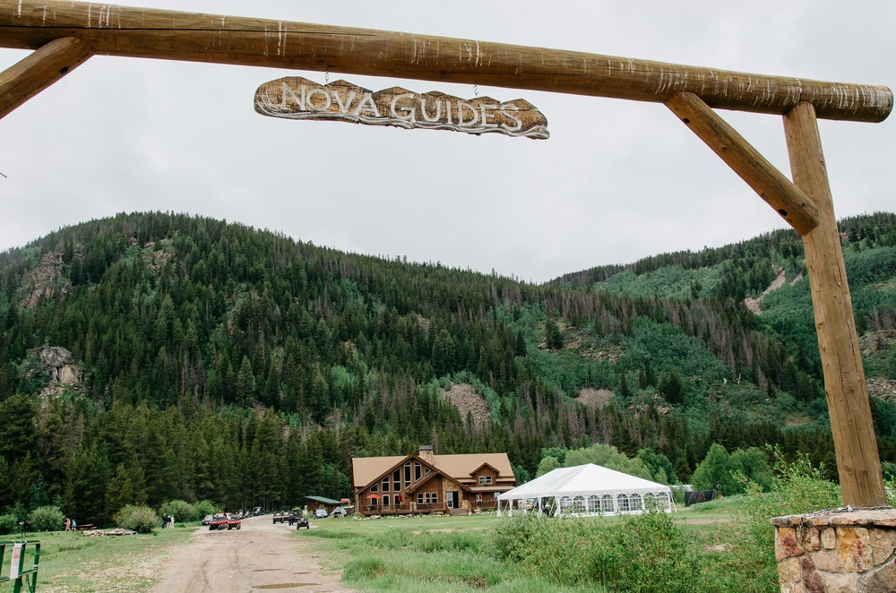 The entry gate at Nova Guides at Camp Hale near Red Cliff, Colorado. Wedding photography by Max Salzburg of Sonja K Photography.